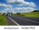 white trucks driving on asphalt ... | Shutterstock . vector #433867903