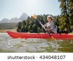 Shot Of Senior Woman Kayaking...