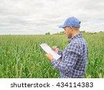farmer in a plaid shirt... | Shutterstock . vector #434114383