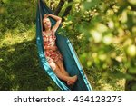 woman laying in hammock and... | Shutterstock . vector #434128273