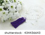 chrysanthemum bouquet and rosary | Shutterstock . vector #434436643