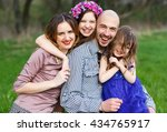family portrait in a park. | Shutterstock . vector #434765917
