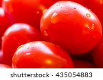 Small photo of Cherry red tomatoes. Cherry tomato is a rounded, small fruited tomato thought to be an intermediate genetic admixture between wild currant-type tomatoes and domesticated garden tomatoes