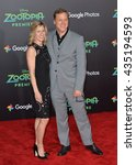 """Small photo of LOS ANGELES, CA - FEBRUARY 17, 2016: Actor Alan Tudyk & fiancee at the premiere of Disney's """"Zootopia"""" at the El Capitan Theatre, Hollywood."""