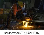 Small photo of Industrial Worker at the factory metal cutting with acetylene gas