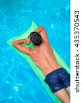 Small photo of man relaxing on the air bed in the swimming pool. vacation and free time