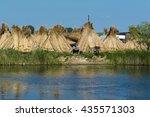 fisherman in the danube delta | Shutterstock . vector #435571303