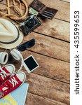 set of trip stuff on wooden... | Shutterstock . vector #435599653
