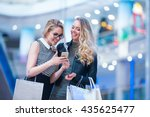 smiling girls with mobile in a... | Shutterstock . vector #435625477