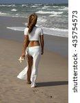 beautiful woman walking on... | Shutterstock . vector #435754573