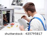 young repairer working with... | Shutterstock . vector #435795817