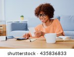 happy young woman calculating... | Shutterstock . vector #435836833