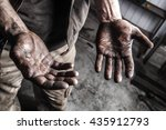 Dirty Hands Of Mechanic At Car...