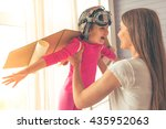 beautiful mother is holding her ...   Shutterstock . vector #435952063