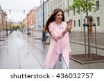modern woman in city texting... | Shutterstock . vector #436032757