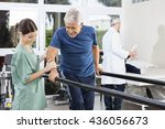 physiotherapist standing by... | Shutterstock . vector #436056673