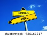 Small photo of Heaven or Hell - Traffic sign with two options. Religious afterlife reward / punishment based on good, evil, sins. Eternal salvation of damnation.
