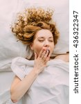 a young girl waking up early in ... | Shutterstock . vector #436322347