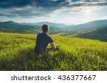 Tourist Sitting On A Hill In A...
