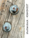 Rusty Bolts On Wooden Pole...