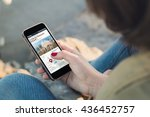 woman holding a smartphone and... | Shutterstock . vector #436452757