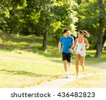 photo of happy couple running... | Shutterstock . vector #436482823