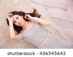 beautiful girl lying on floor | Shutterstock . vector #436545643