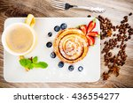 cup of coffee and pastry on... | Shutterstock . vector #436554277