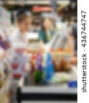 Small photo of Blurred cashier counter in supermarket background