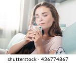 young woman sitting on couch at ... | Shutterstock . vector #436774867