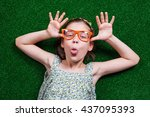 happy little girl is lying on... | Shutterstock . vector #437095393