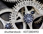 Small photo of Macro photo of tooth wheel mechanism with ASSET MANAGEMENT concept letters