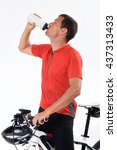 cyclist drinking water | Shutterstock . vector #437313433