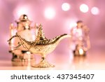Small photo of Silver Aladdin's lamp on out of focus lights as background. Ramdan , Eid Mubarak concept.
