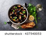 Mussels In Copper Pot And Whit...