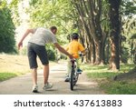 father learn his little son to... | Shutterstock . vector #437613883