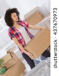 woman in a new home with... | Shutterstock . vector #437670973