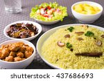 Small photo of Yellow rice and curry or kaha bath dark background Sri Lankan food