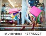 Shopper In Casual Wear Walking...