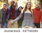 group of happy friends hiking... | Shutterstock . vector #437760283