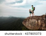 two hikers standing on top of a ... | Shutterstock . vector #437805373