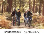 Group Of Friends On Bikes In...