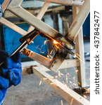 Small photo of metal cutting with acetylene torch in factory