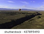 Hot Air Balloon Flying Over Th...