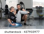 personal trainer showing young... | Shutterstock . vector #437933977
