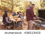 Man Barbecues For Friends At A...
