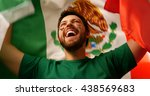 Mexican Fan Celebrates Holding...
