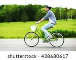 A Young Man Riding A Bicycle I...
