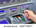 woman holding card  using atm | Shutterstock . vector #438779857