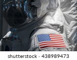 American Flag On Astronaut...